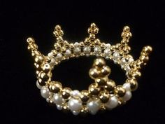 """This is a very small crown that matches it's description of being a very simple crown with seven peaks. It comes in two different sizes, determined by the size of beads used. The small crown is 2 ¼"""" wide by 1"""" high. The large crown is 2 ½"""" wide by 1 ½"""" high. Even though they are"""