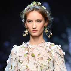 The Evolution Of The Flower Crown - Dolce & Gabbana's Spring 2014 runway Dolce & Gabbana's runway hair emanated Italian romance with intricate flower crowns placed at the back of the head. Peeking out just slightly when viewed from the front, the effect was soft and folksy. | The Zoe Report