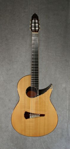 Uchida Alpha (1997) Acoustic Spruce top #Guitar, Brazilian Rosewood back & sides. http://ozmusicreviews.com/christmas-gifts-for-guitarists