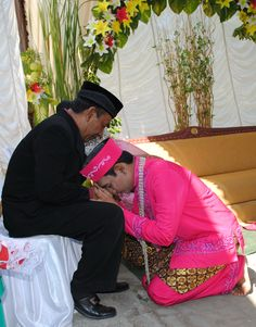 Sungkeman    Wedding ritual on Javanese people, Sungkeman means ask for parents forgiveness, symbolising how important the parents bless for couple in marriage in Javanese tradition