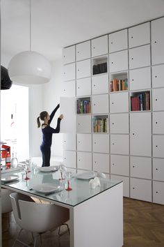 Bieke Claessens--photographer. Designer: Filip Janssen. I love this. An area for my books and crafts AND dishes all in one spot and easily organized! I wish I had this much wall space, but...there it is!