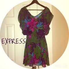 SaleEXPRESS pretty green floral dress. This green dress has pink and purple flower accents. It has an elastic waist for comfort and it can easily be dress up or down. Fully lined. Express Dresses