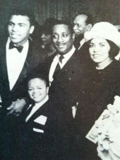 Photo in the 67th anniversary convention issue of The Sphinx (Alpha Phi Alpha Fraternity). The little man in the front is Frankie Dee, who was also an Alpha. Dee was a well known midget performer. He was actress Ruby Dee's first husband. For show biz reasons she never used Ossie's last name of Davis. This is the man whose name she kept. A little history!! Muhammed Ali, John H. Johnson (founder of EBONY, JET, Fashion Fair and member of Alpha), Eunice Johnson (Fashion Fair Founder), Frank Dee