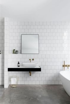 This classy minimalist modern monochrome bathroom has utilised concrete flooring perfectly. Read more at: https://nyde.co.uk/blog/bathroom-inspiration/