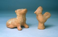 Agora Image: Terracotta animal rattles: sitting dog wearing a collar (left, T 1510) and a cock (right, T 1423). Toys and rattles were immensely popular, especially the horse on wheels.
