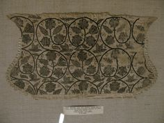 English coif, Victoria and Albert Museum, London, late 16th century. Brown silk in braid, stem and double-running stitches on linen, edged in bobbin lace. T.12-1948