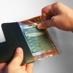 """Revolutionary new paper computer shows flexible future for smartphones and tablets / """"This is the future. Everything is going to look and feel like this within five years,"""" says creator Roel Vertegaal, the director of Queen's University Human Media Lab,. """"This computer looks, feels and operates like a small sheet of interactive paper. You interact with it by bending it into a cell phone, flipping the corner to turn pages, or writing on it with a pen."""""""