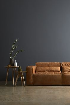 the style fix featuring our bergen sofa in tan leather accompanied by the oscar