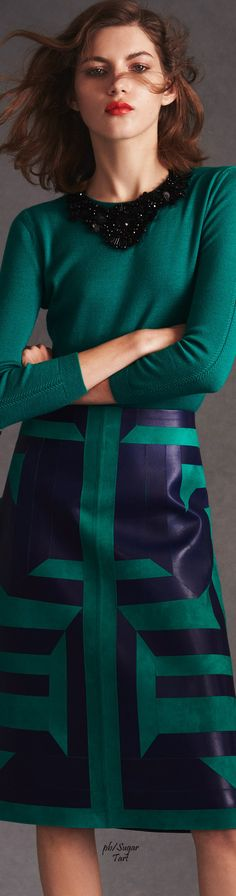Green and navy is my dream color combo. Love the embellishments on the sweater and the pattern on the skirt.