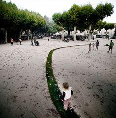 grass path winds through Jaujac by Gaelle Villedary