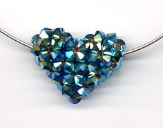 Weave together Swarovski crystals with this Puffy Heart Pattern (and WITHOUT threading a needle) to make this sparkly 3-D pendant. Check out the Crystal Balls tutorial for Coordinating earrings - woven crystal heart pattern free Supplies needed: 73 Swarovski crystals, monofilament, 16-inch sterling silver omega chain, GS Hypo Cement, scissors or nail clippers. Click here for tool information. Tutorial $7