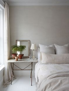 This serene bedroom with European rustic elegance looks as though it might be in the South of France, not New York.see more lovely examples of European farmhouse decor you can bring to your own spaces at home. Serene Bedroom, Bedroom Colors, Beautiful Bedrooms, Home Bedroom, Bedroom Furniture, Bedroom Decor, Master Bedroom, Gray Bedroom, Design Bedroom