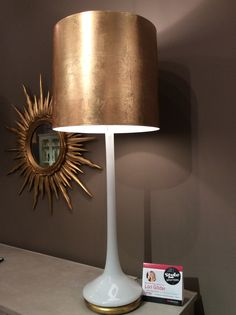 These handblown Monet lamps from Modern History have a beautiful slim line and brilliant glow. The gold leaf shade and lamp base add subtle glamour to a modern classic shape. Modern History 430 N. Wrenn St.