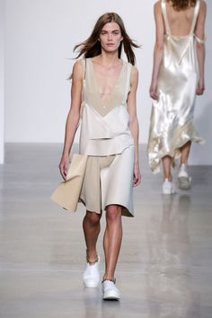 The inner wear as ready-to-wear was further explored as he turned chemises into dresses done in neutrals and cut in architectural shapes. Note the way the anklet chains catch the tiny chain at the shoulder and bodice.