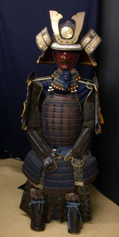 This armor is not so old --- perhaps 30 years or so. But the shoulder guards make it an O-Yoroi and the helmet I thought was very nice with huge red Shikoro