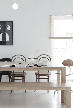 light tan wooden dining table and bench