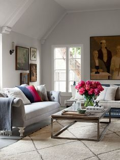 The homeowner of this California home painted the wooden Moroccan settee with basic gray primer and found the Berber rug in Marrakech. The large oil portrait is by contemporary Scottish painter Peter White, and the oak-and-steel coffee table hails from H.D. Buttercup. The swap-meet Chesterfield sofa was a flea market find reupholstered with Ikea linen.