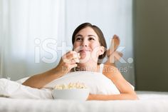Smiling woman watching TV royalty-free stock photo