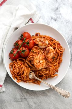 Garlic Butter Shrimp Linguine in Tomato Sauce! Such an easy and delicious pasta recipe everyone will love. Pan fried in a skillet while the tomato sauce simmers along. You can make it spicy or leave it as-is, and even serve it over spaghetti, rice or quinoa. An easy, healthy dinner idea!