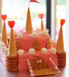 castle cake using cones, crackers, marshmellows and lollypops