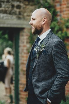 Groom wears a tweed jacket and navy trousers and waistcoat | Photography by http://alipaul.com/