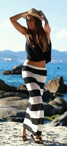 Black and white stripe maxi skirt, little black flaired crop top, straw hat completes the look.