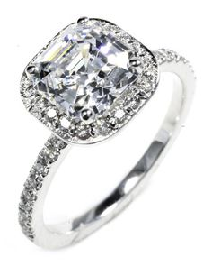 Cushion-cut diamond engagement ring with halo pave setting in platinum from OGI Ltd.