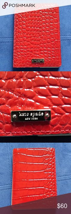 Kate Spade passport holder Brand new Kate Spade passport holder Beautiful alligator skin Nice red color Fancy golden tag in the front No stains Pet free and smoke-free home kate spade Accessories Key & Card Holders
