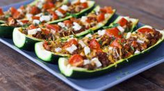 stuffed zucchini - good sub for stuffed peppers! Swap out beef for lean ground turkey and low fat cheese
