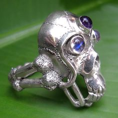 This is ring designed for the young and funky heart . Cleverly designed with a combination of amethyst, moonstone and crafted silver sterling. Like the crystal skulls of old this ring has a feel of wisdom to it.