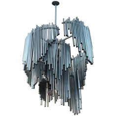 Italian High Style 1970s Sculptural Chandelier | From a unique collection of antique and modern chandeliers and pendants at https://www.1stdibs.com/furniture/lighting/chandeliers-pendant-lights/