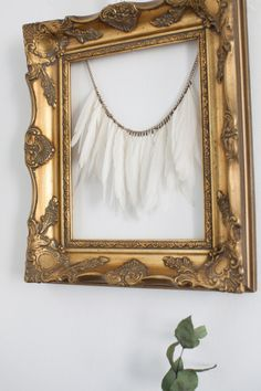 I hung this feather necklace in a frame to just work with textures.