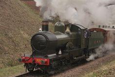 Dukedog #9017 rushes under Three Arch bridge on the Bluebell Railway.