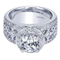 This 14k White Gold Victorian Halo Engagement Ring will make anyone stop in their tracks!
