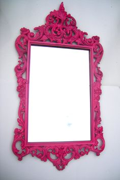 Hollywood Regency Vintage hot pink mirror: ornate hot pink mirror vintage home decor. $148.00, via Etsy.