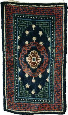 19th century, Tibet, Red and green saddle rug/Tapis pour selle de cheval , wool.