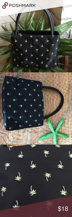 Palm Tree 🌴 Bag NWOT Must Have Darling Summer Time Palm Tree 🌴 Bag. Color is black with green & brown palm trees on back & front. Silver tone zipper closure with a sun pull. Inside lined in black with a middle zipper compartment & 1 back wall zip compartment. 2 non closure compartments. Carry in crook of arm or in hand without a jacket on I can make it on my shoulder. All man made materials. Great bag for a vacation also ! NO TRADES. Bags Mini Bags