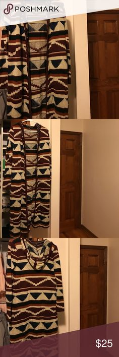 Aztec Print Long Sweater This sweater is in amazing condition. It has been barely worn so the colors and everything are still so vibrant/amazing. If you're wondering the length of the sweater, I'm 5'5 and the sweater reaches just under my knees. Forever 21 Sweaters Shrugs & Ponchos