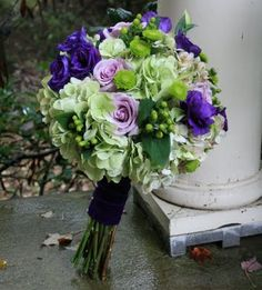 Round bouquet featuring roses, lisianthus, hydrangeas and Kermit chrysanthemums