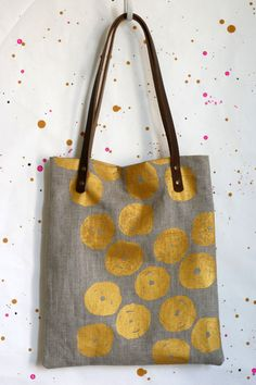 gold dot linen tote with leather handles.