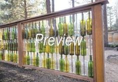 Mel and Mike Steinbach''s wine-bottle fence was made by drilling a hole in the bottom of each bottle and running a piece of rebar through it. - Ryan Brennecke / The Bulletin by proteamundi