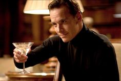 Fassy in a black turtleneck on X-men First class <3 (drinking a martini, which I read is his favorite drink, when made correctly which he says is hard to do!)