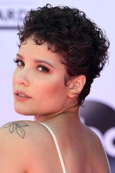 Don't be afraid of going super-short if you have curly hair. Pixie cuts like Halsey's are low-maintenance — just run a little gel through your hair, muss it up and enjoy the air-dried results.