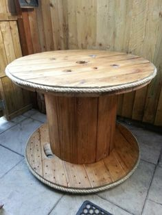 Natural looking patio table. just gave it a light sand, stain and varnish then added rope. Looks great in the garden