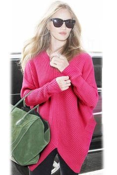 Asymmetrical Pullover Sweater for women. An oversized silhouette designed in panels of ribbed Italian wool, finished with an asymmetrical neckline and hem for a modern twist. Modified ribbed crewneck.