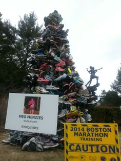A moving memorial along the course of the Boston Marathon to Meg Menzies, a runner who was killed by a drunk driver while she was out for a run on January 13, 2014... #megsmiles.