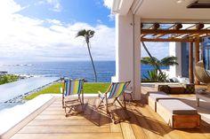 I would love a house on a sunny beach. Right on the sand.