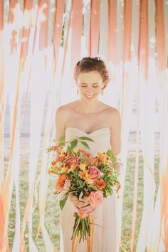 peach silk ribbon backdrop.