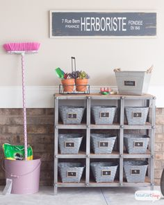 Pretty and Organized Garage at Chic Chateau Dollar Store baskets spray painted with chalkboard labels added.