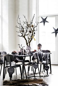 I like the idea of hanging chalkboard shapes from the chair backs with the guests name.